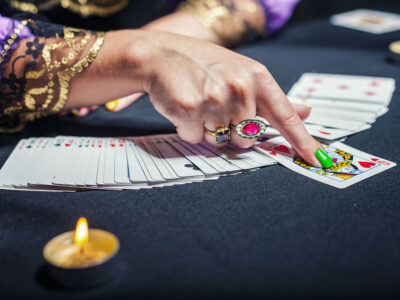 63569044 - close up of sorceress telling fortunes using cards
